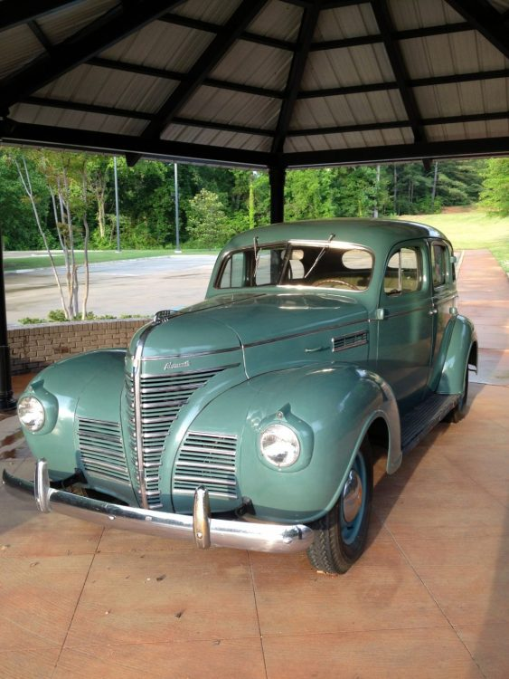 Replica of the 1939 green Plymouth sedan that carried Elvis' family to Memphis.