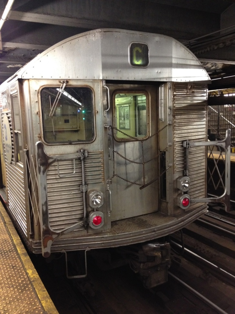 The C train sitting in the 168th Street station.