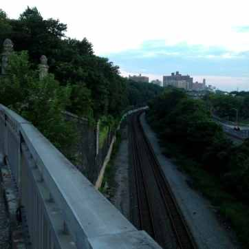 A set of train tracks that run along the river.