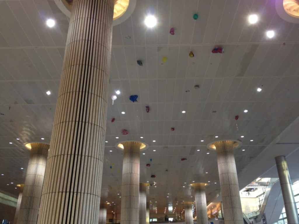 Balloons on the ceiling from families greeting returning loved ones.