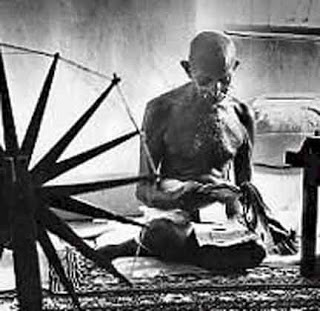 Gandhi with a spinning wheel in India