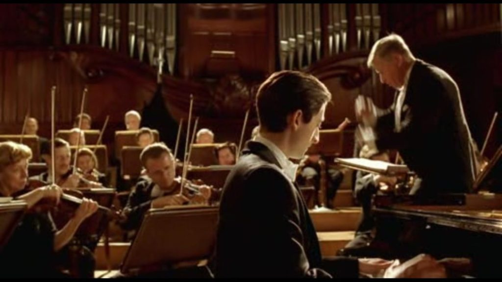 The closing scene of The Pianist, where Szpilman's return to humanity is shown through his performance.