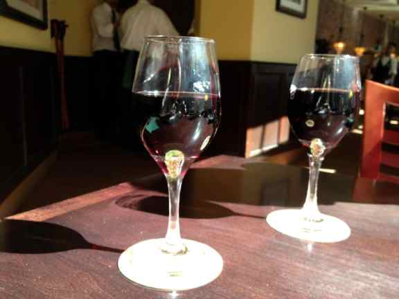 Two glasses of Olive Garden Rosso House Wine