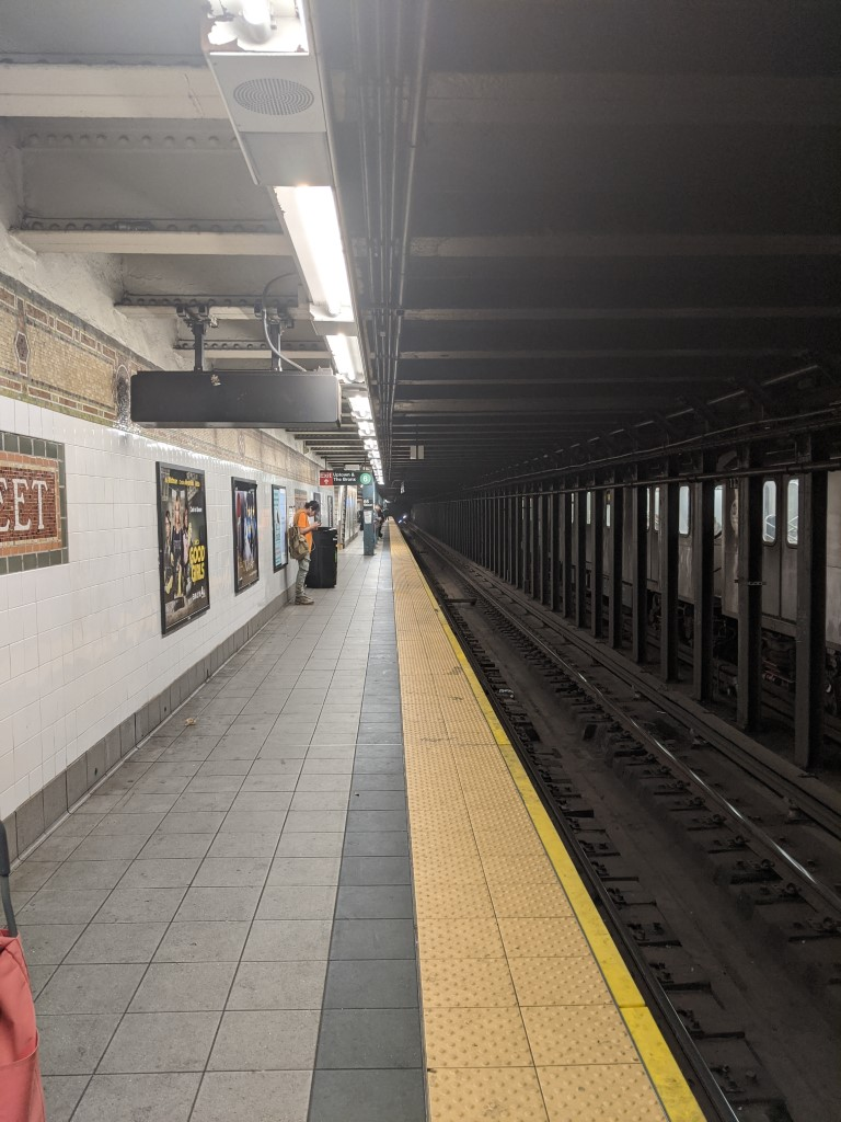 The uptown 4 train platform at 86th street on 3/20/2020, almost completely empty of people