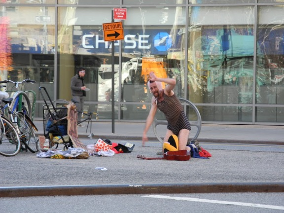 Man With A Bra on His Head Dancing at Astor Place