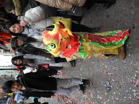 Little girl in a dragon costume