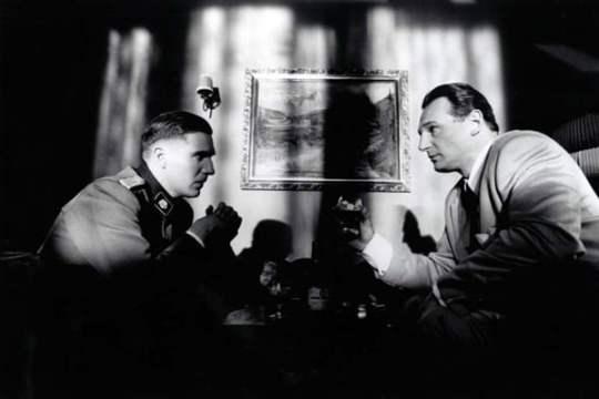 Oskar Schindler and Amon Goeth from Schindler's List