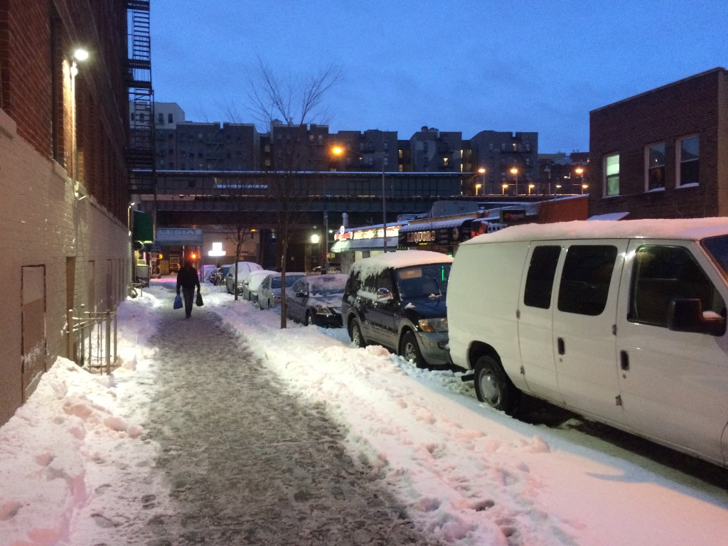 Snow accumulation on 176th Street in the Bronx, New York City.