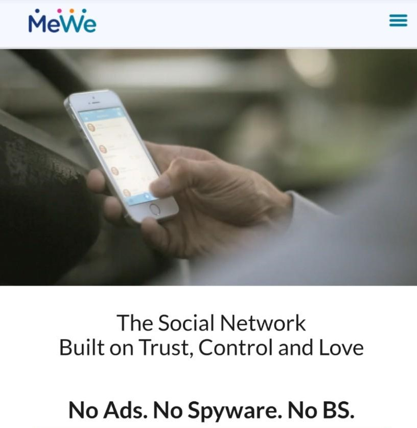 """A screenshot of a sign-up page for MeWe including an image of a hand holding a smartphone showing MeWe and the text """"The Social Network Built on Trust, Control and Love; No Ads. No Spyware. No BS."""""""