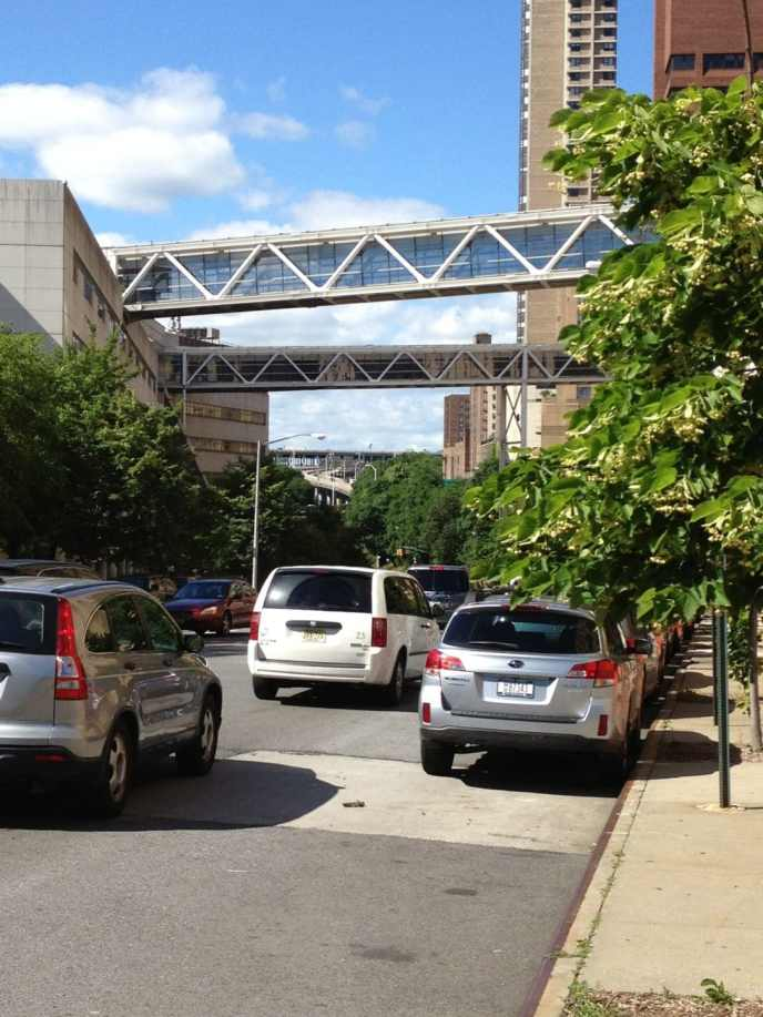 Enclosed bridges at Columbia Presbyterian Hospital and bridge on-ramps for the George Washington Bridge in the background.
