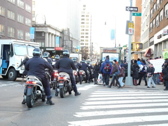 Two rows of motorcycle cops