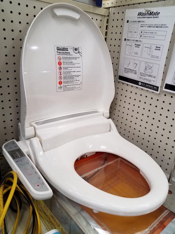 Japanese bidet toilet attachment.