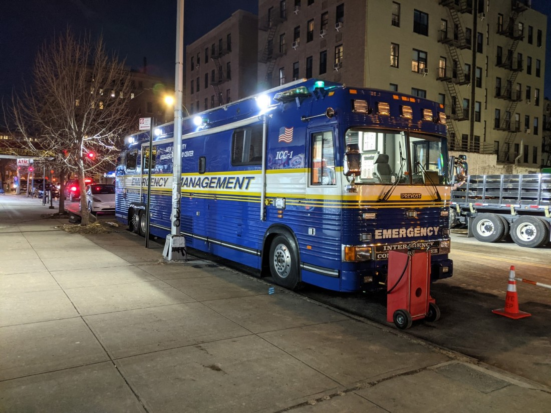 A picture of the NYC Emergency Management Bus parked along the curb on 175th Street near Jerome Avenue